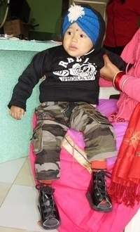Little Nepalese boy with his special shoes for clubfoot
